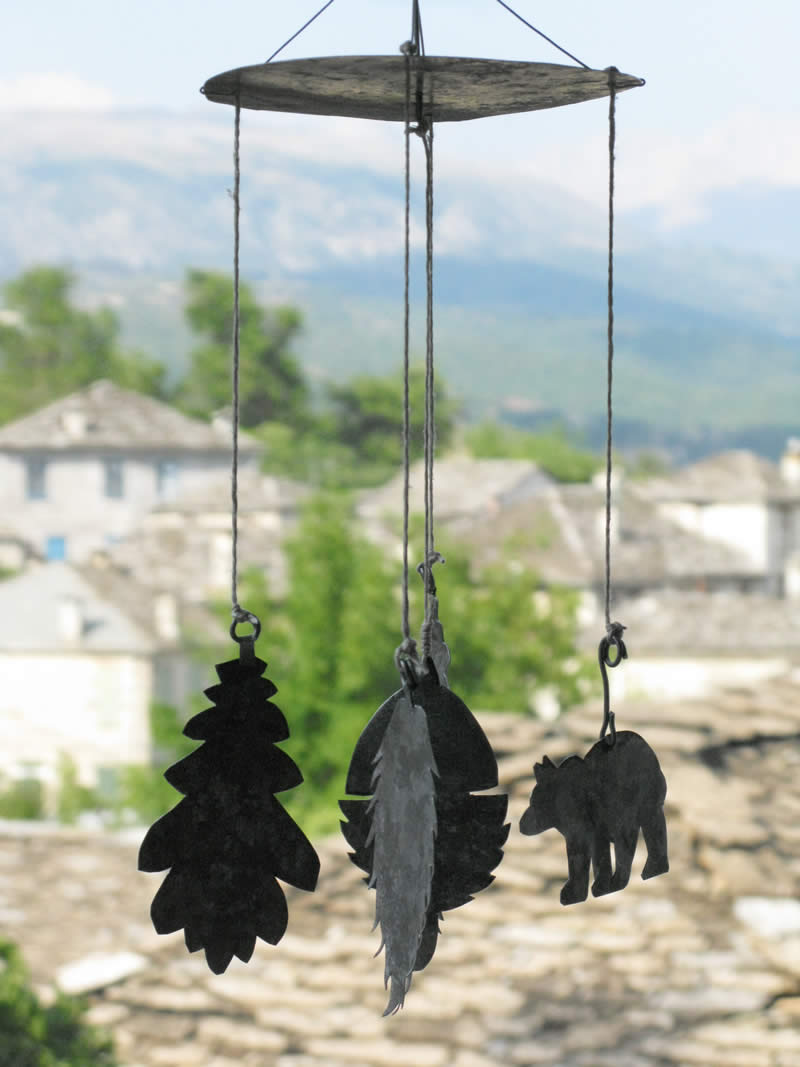 wind chime with animals and leaves made from reclaimed galvanized metal