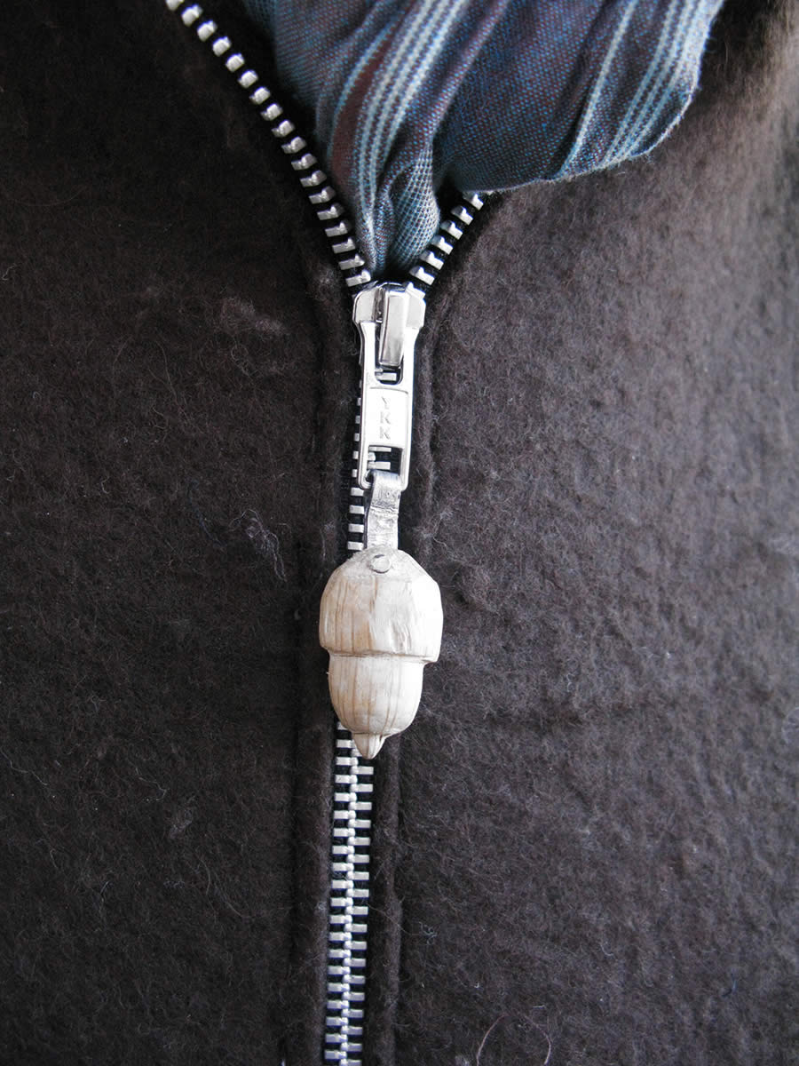 detail: the oak on the zip of the felt jacket