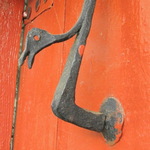 old door knocker on a door of an old stone house in vradeto village, the highest in zagori at 1.340m altitude