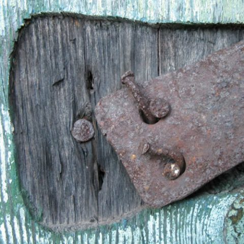 an old rusty door hinge on a traditional door in zagori