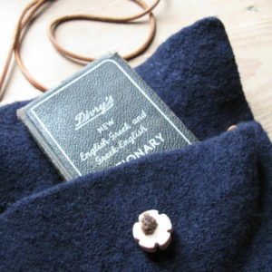 dark blue felt purse