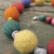 Handmade felt bracelets and necklace with woolen and wooden beads in fun colours