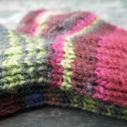 Colourful knitted socks in various sizes