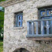 scale traditional stone house in zagori