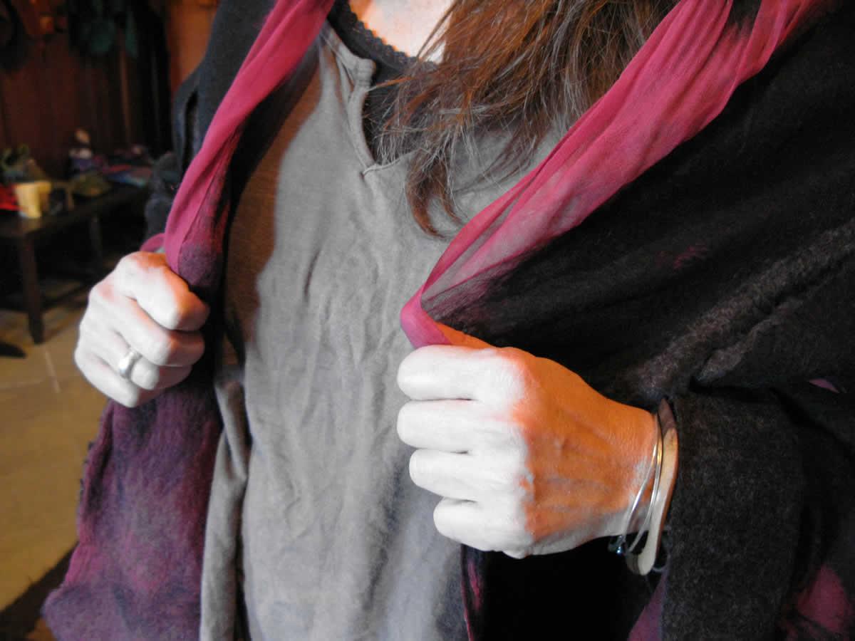 trying on a women's wool & silk felt vest