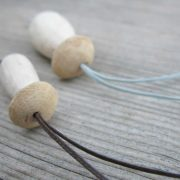 Handmade porcini necklaces made from oak wood and waxed thread