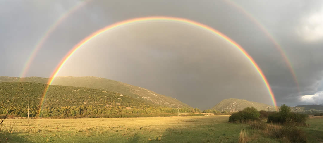 Amazing rainbow over Soudena (Pedina) Valley in Zagorochoria